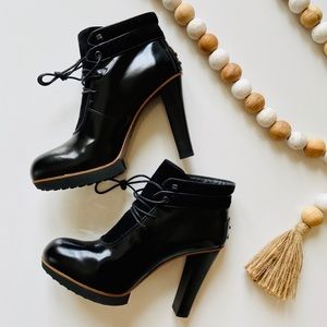 NWT Tod's lace up high heeled black ankle booties